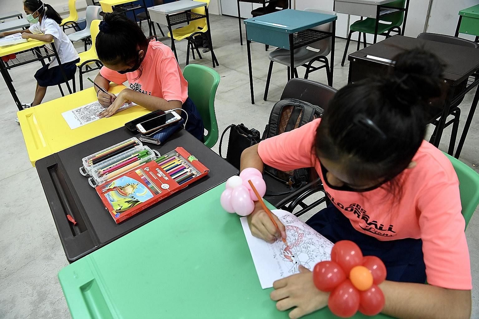 Secondary 2 students at Serangoon Garden Secondary working in class on April 22 during the home-based learning period. Teachers made arrangements for a small number of children who, for various reasons, wanted to do their learning in school. ST PHOTO