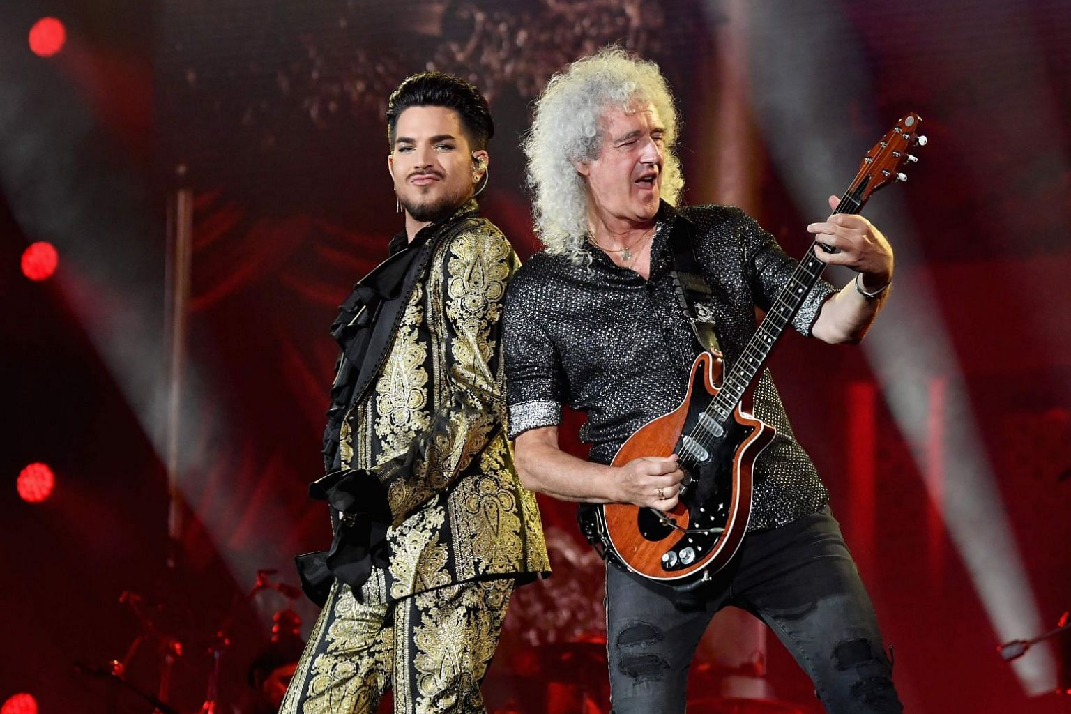Adam Lambert (left) and Brian May of rock band Queen performing last year. Queen and Lambert have recorded a new version of We Are The Champions on their mobile phones under lockdown.