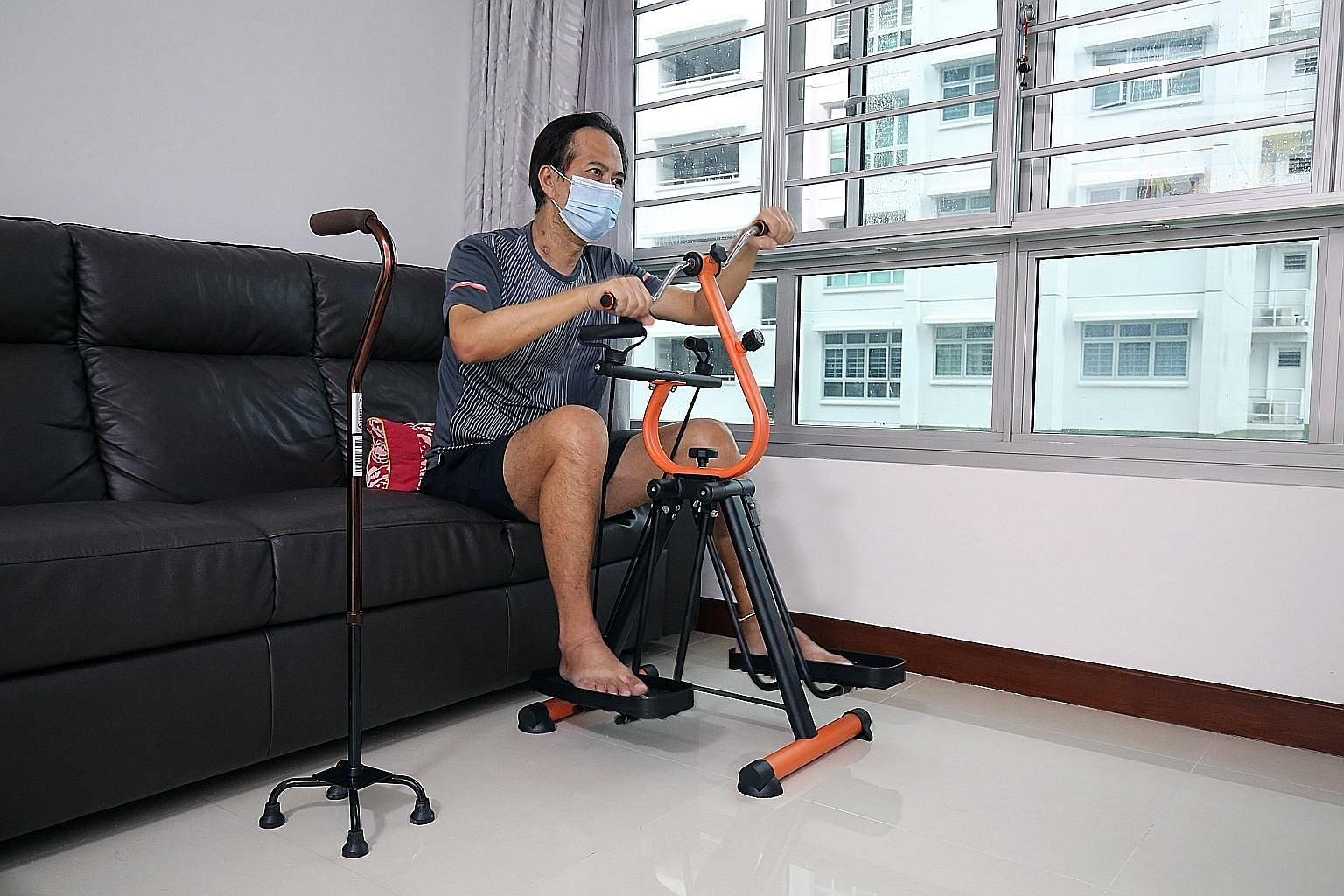 Mr Toh doing exercises at home to aid his recovery. He now requires a walking stick to support him in his movements. For 13 days, he had to rely on a ventilator to help him breathe. Left: Mr Toh Kai Kiat's neck still bears bruises from the tubes that