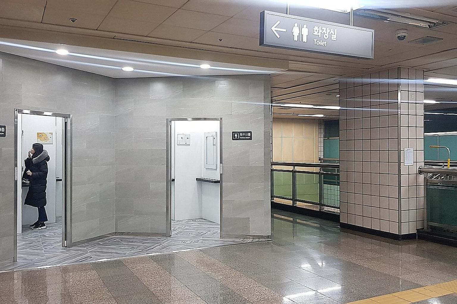 South Korean Ham Jung-min, 22, with the contents of his make-up pouch. He finds that his face looks better with make-up. Samgakji subway station in central Seoul features two powder rooms - one for women and one for men. With more men using make-up,