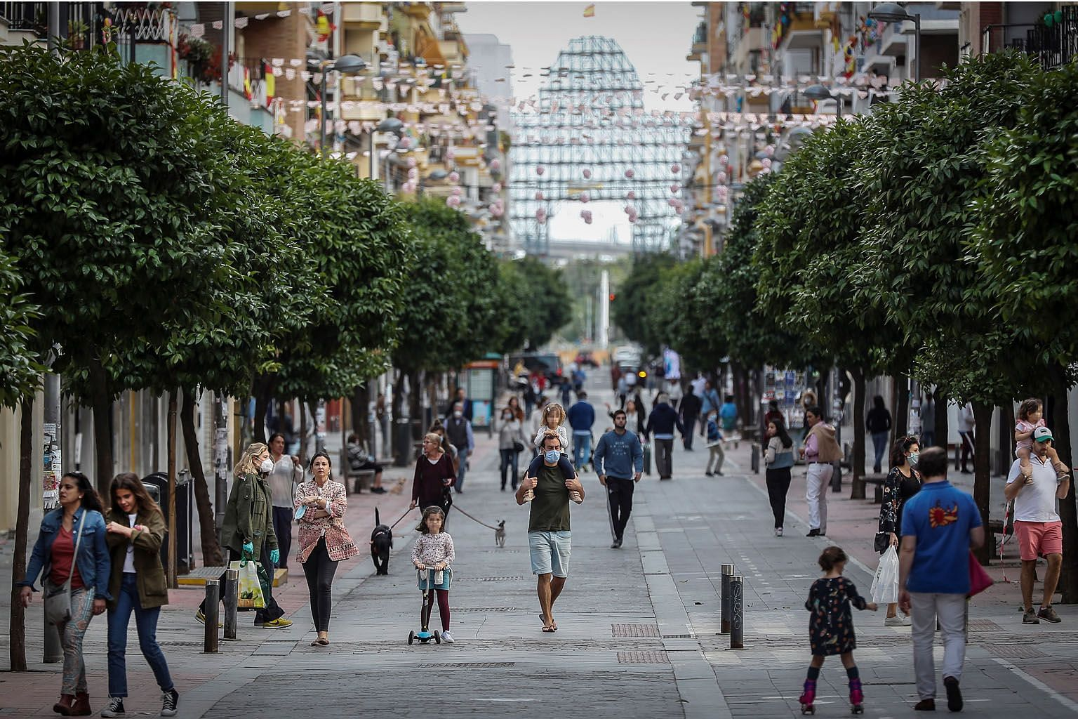 People walking down the San Jacinto street in the Spanish city of Sevilla on April 26, the first day minors were allowed an hour's walk per day since a lockdown was ordered in March. The writer says that amid the Covid-19 pandemic, ''faith is being tested