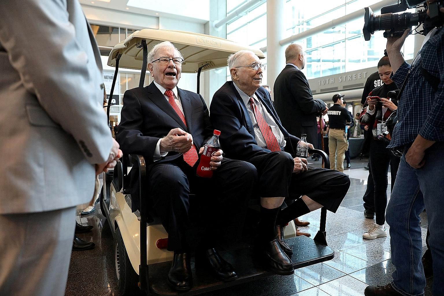 Berkshire Hathaway chairman Warren Buffett (left) and vice-chairman Charlie Munger at last year's annual Berkshire shareholder shopping day in Omaha, Nebraska. This year's meeting was devoid of such events.