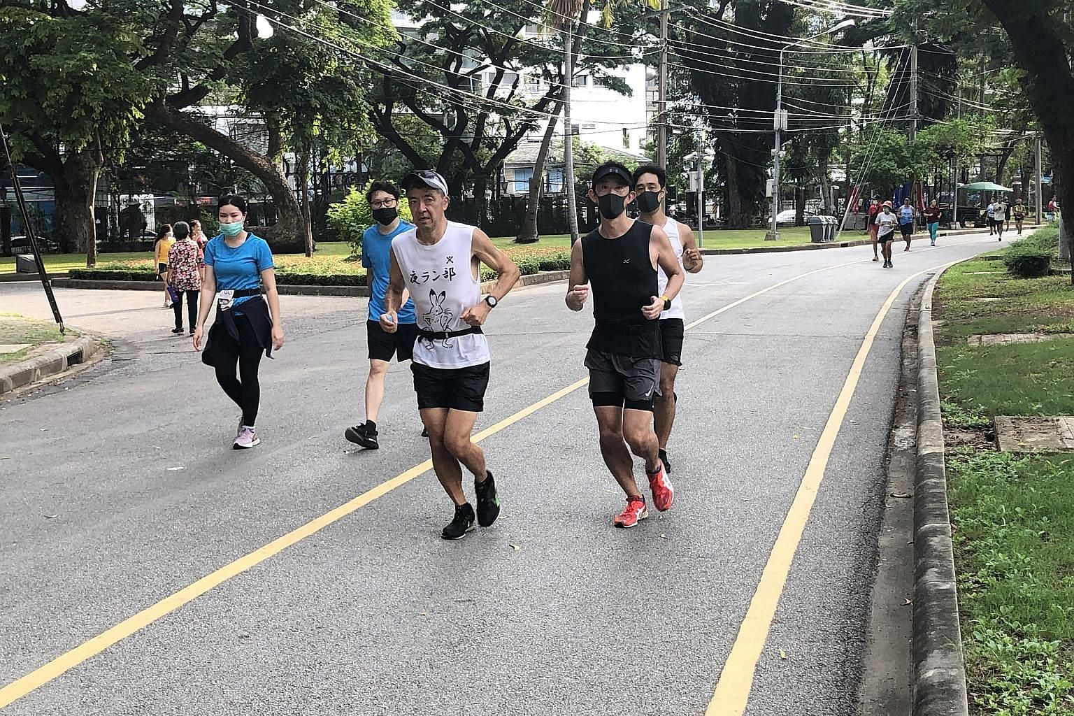 Joggers at Lumphini Park in Bangkok yesterday morning as Thailand started relaxing its anti-virus measures.