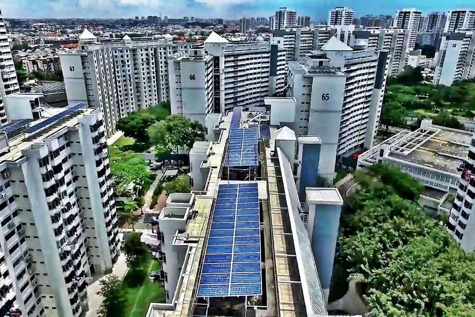 Solar panels installed by energy company Sunseap on Housing Board rooftops. Singapore achieved its 2020 solar deployment target of 350 megawatt-peak in the first quarter. PHOTO: SUNSEAP