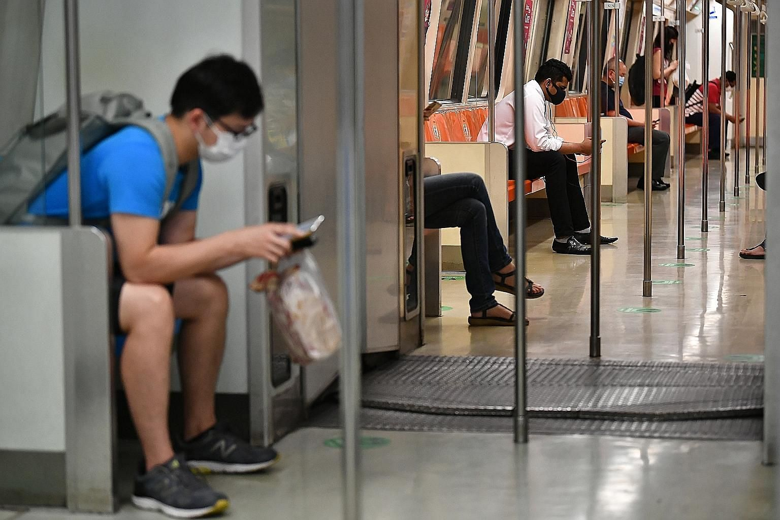 MRT trains are now marked with safe distancing stickers, and are also running at lower frequencies because of lower demand.