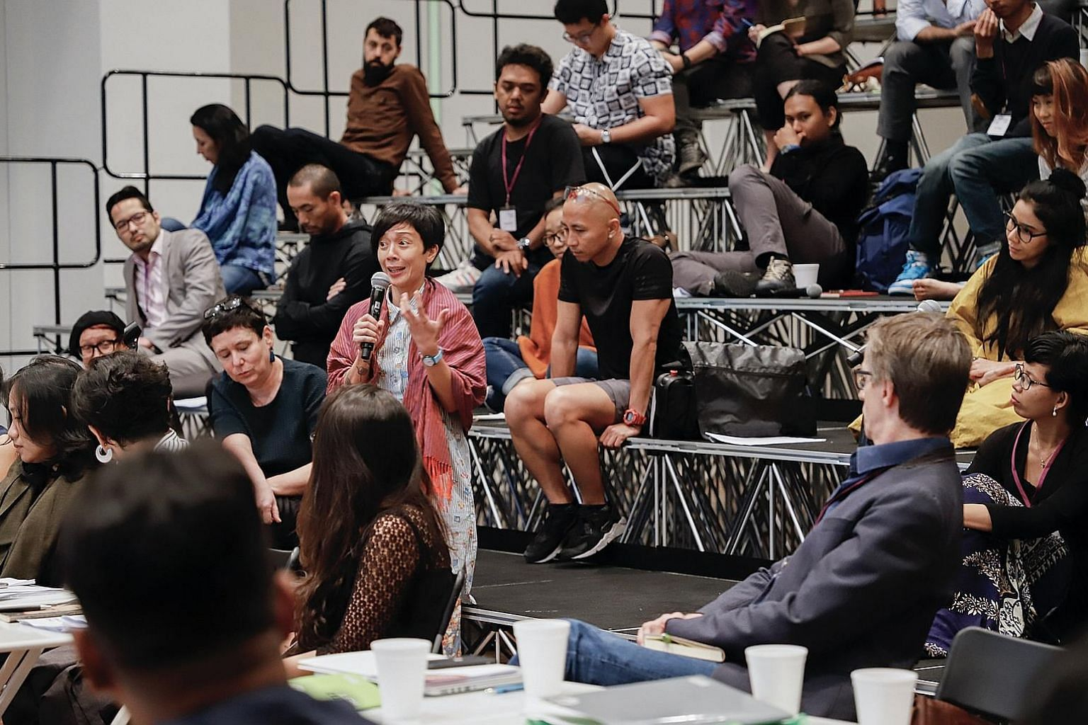 A Curators Academy session in Singapore in 2018 (above). Founded by theatre veteran Ong Keng Sen (left), T:>Works' artistic director, the academy's programmes include an upcoming curators training course.