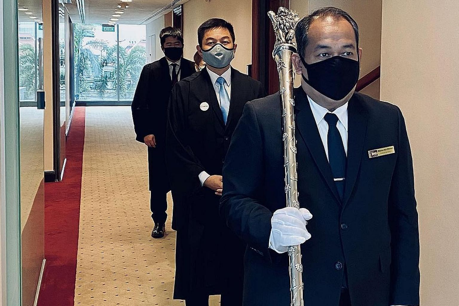 From front to back: The Serjeant-at-Arms shouldering the mace, a symbol of the Speaker's authority, Speaker of Parliament Tan Chuan-Jin, the Clerk of Parliament (partially hidden) and an assistant clerk before they entered the Chamber yesterday.