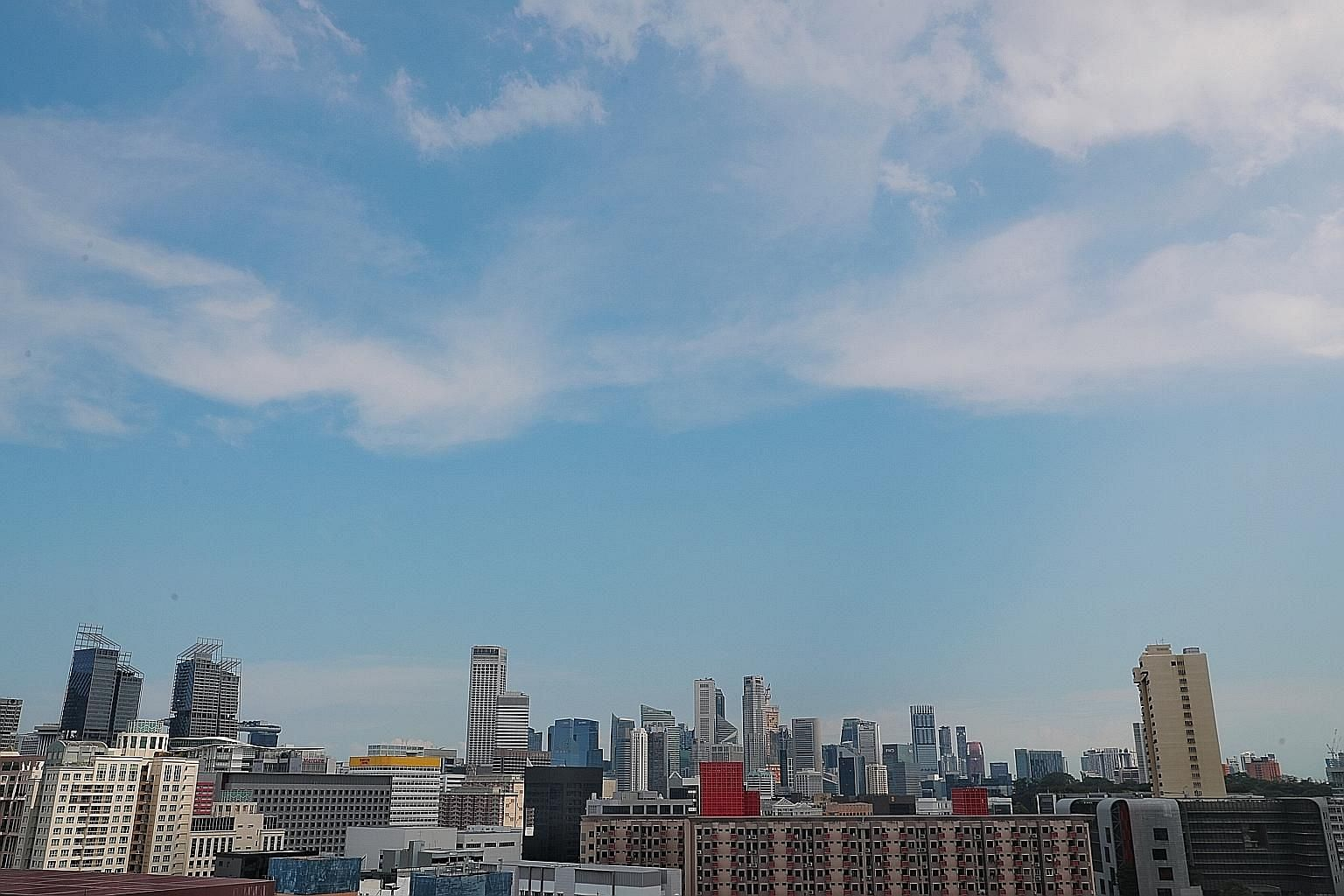 """Clear blue skies photographed from Buffalo Road yesterday. The National Environment Agency said all the daily pollutant levels in Singapore are now """"within World Health Organisation air quality guidelines"""". Singapore has long been unable to meet some"""