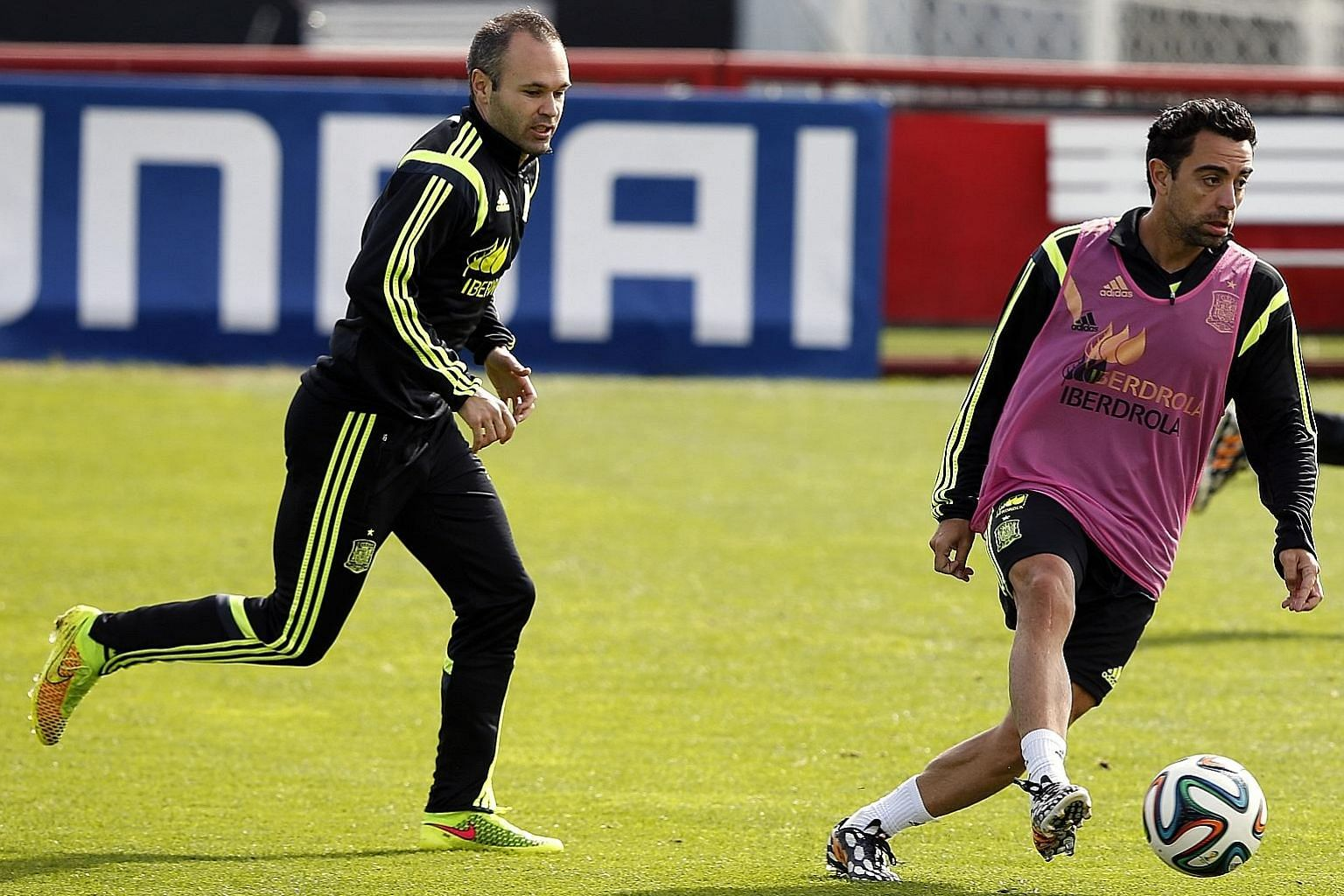 Xavi Hernandez (with ball) and Andres Iniesta training in Brazil with Spain's national team, then the holders, for the 2014 World Cup. PHOTO: EPA-EFE