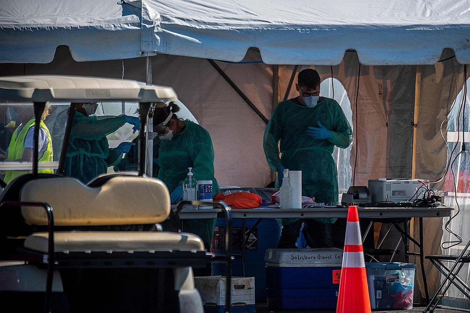 A Covid-19 drive-in testing site in Salisbury in America's Maryland state. A US study suggests easing lockdowns by the end of June may save 18 million jobs in the US but add over 200,000 virus deaths. PHOTO: AGENCE FRANCE-PRESSE