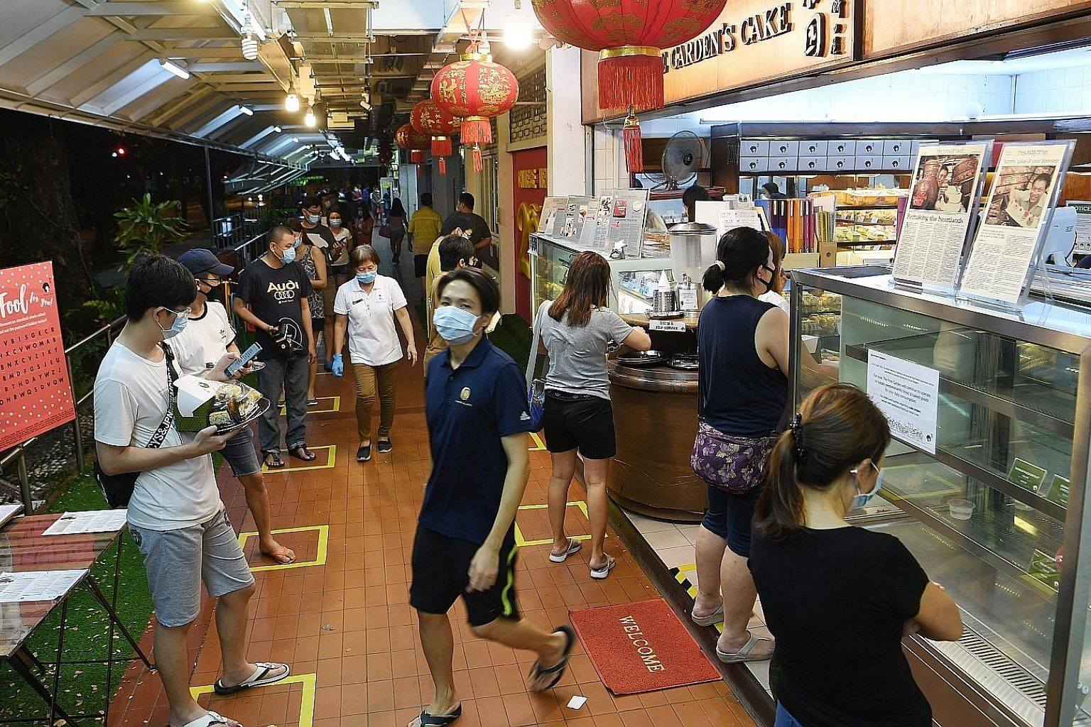 The queue at The Pine Garden bakery in Ang Mo Kio on April 22, following the announcement that tighter circuit breaker measures would kick in on 11.59pm that day. Like all other food outlets selling cakes and confectionery, it can resume selling cake