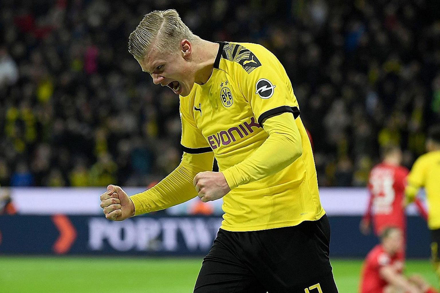 Dortmund's teenage Norwegian forward Erling Haaland celebrating a goal in the Bundesliga match against Leverkusen in February. He netted a hat-trick when he came on as a second-half substitute on his debut against Augsburg the month before.