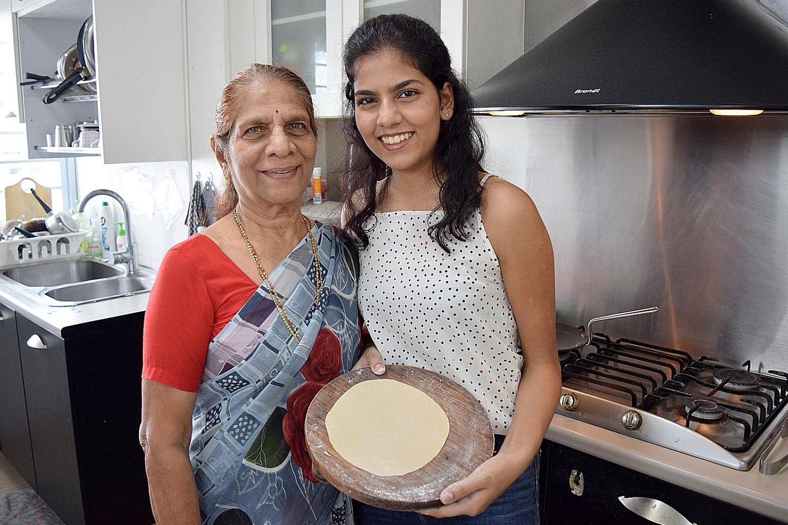 The writer, 19, is using the circuit breaker period to learn to make rotis from her grandmother, Mrs Neela Phatale (both above).
