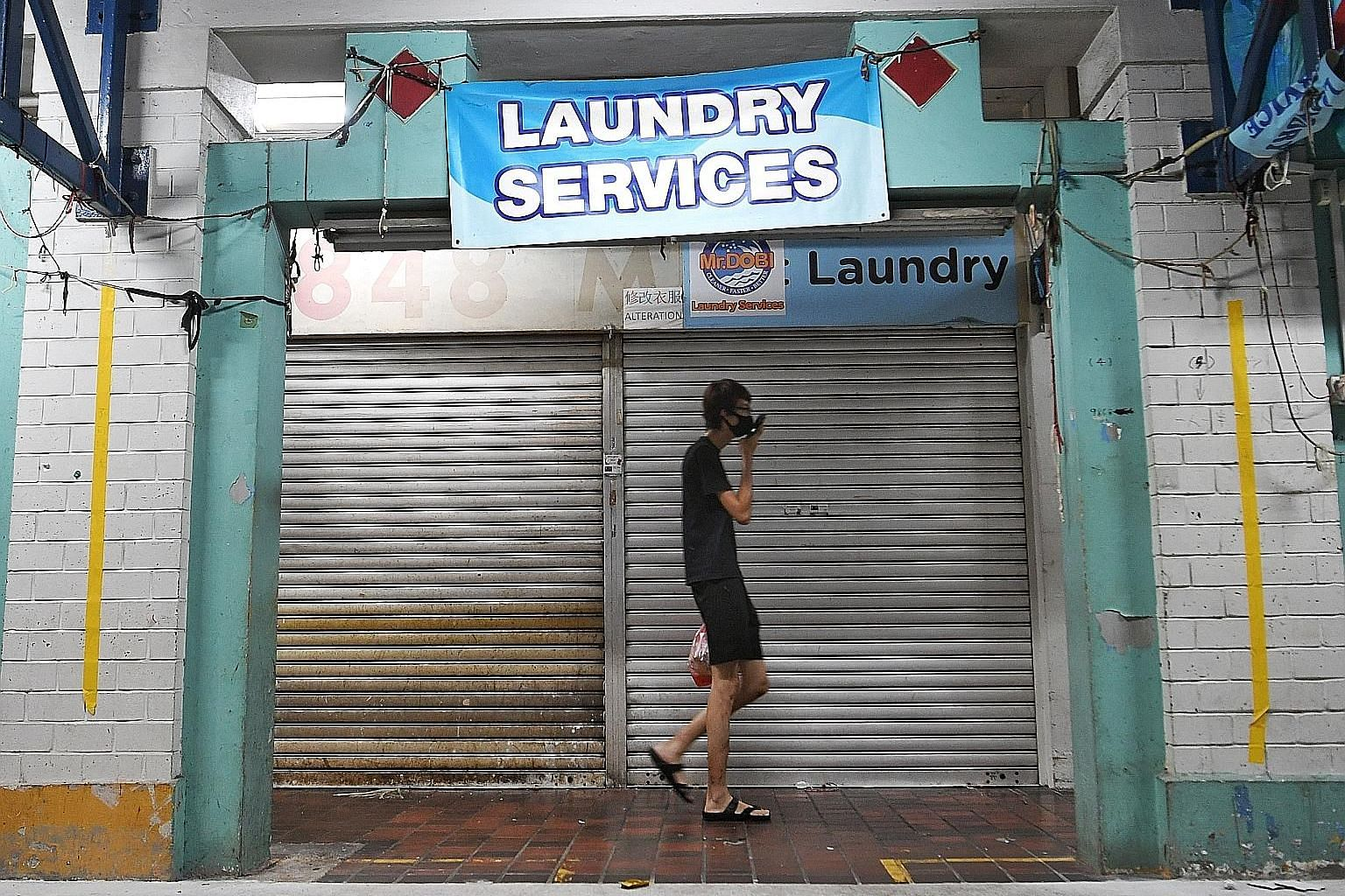 Mr Dobi Laundry Services in Yishun is one of the laundry shops that may not reopen yet, while some shops are planning to resume business with shorter opening hours and others are saying they will not allow walk-in customers. ST PHOTO: KHALID BABA