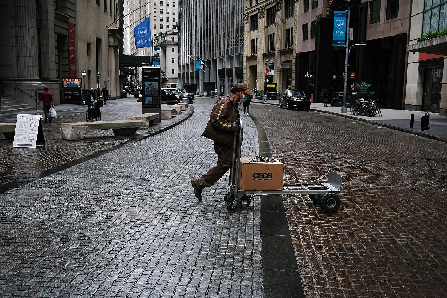 A view on Friday of the financial district of New York City, which is under lockdown during the coronavirus pandemic. The United States, the largest economy in the world, has been hit hard by Covid-19, with the unemployment rate climbing to 14.7 per