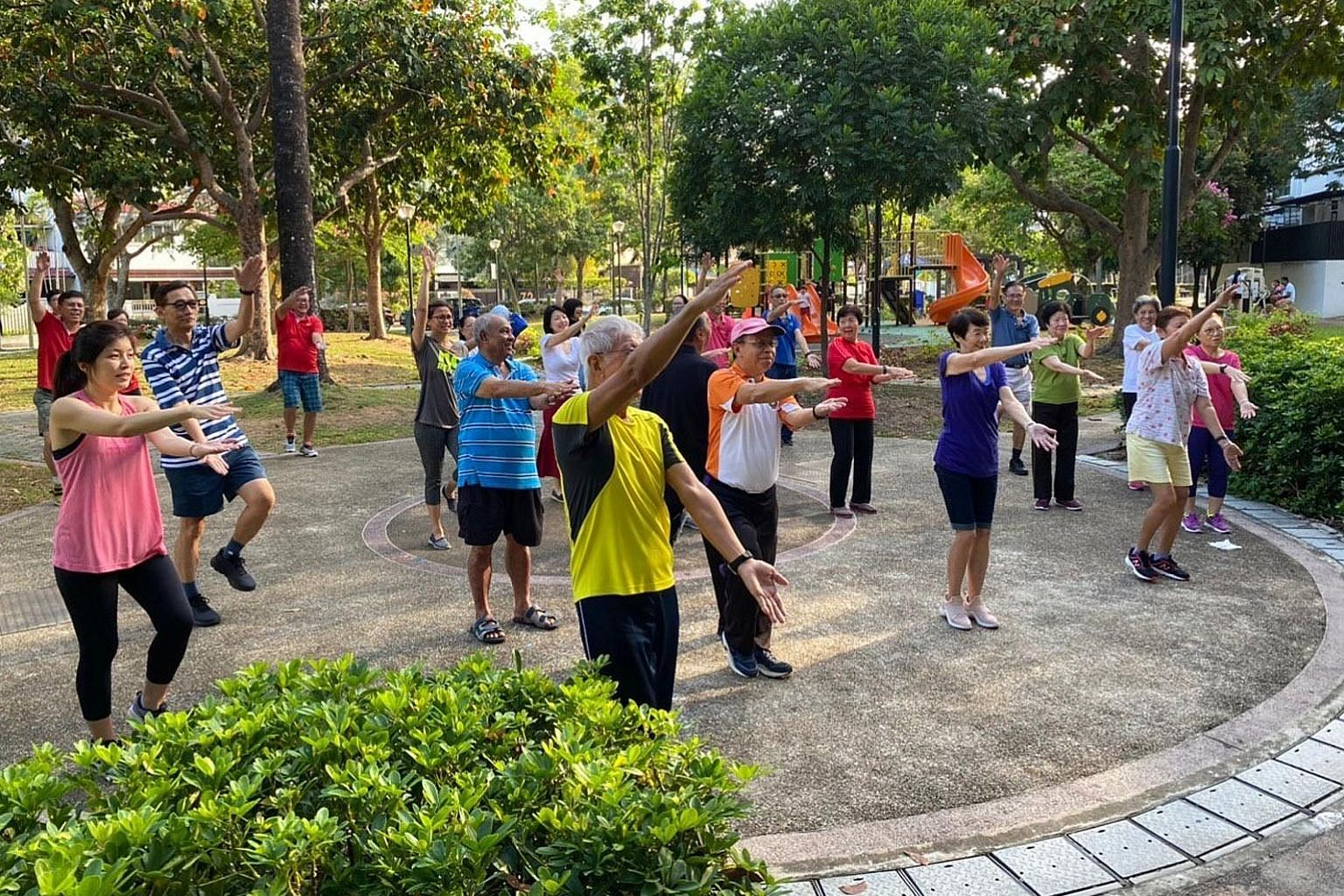 Participants of the Happy programme doing physical and mental exercises at Jalan Pari Burong prior to the circuit breaker.