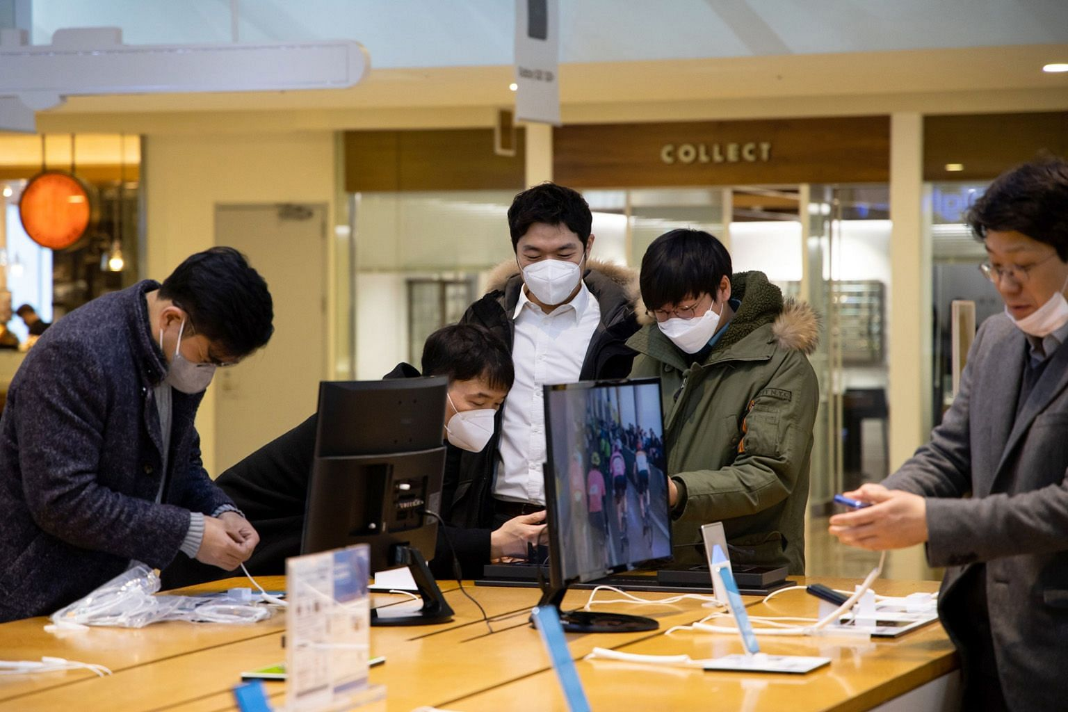 Customers trying out smartphones at Samsung's flagship store in Seoul in March. The coronavirus pandemic has hit sales of mobile devices across the board and experts warn that the rest of the year will be worse as the virus batters the global economy