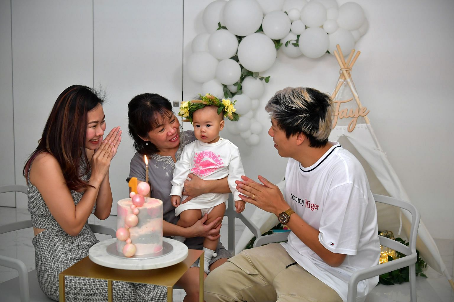 Above: Madam Lim Bee Wah, 56, quit her job of 14 years last year so her daughter Tam Xiang Ying, 32, seen here with husband Kelvin Chua, 36, and daughter, Faye, would not have to give up her job to care for the baby. ST PHOTO: NG SOR LUAN