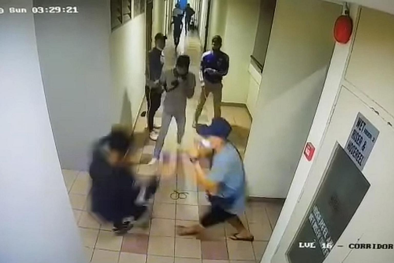 Left and below: The minute-long video clip, widely circulated on social media, shows a group of men being attacked by another group armed with parangs at the People's Park Centre building. It also shows a man being attacked by at least three people w