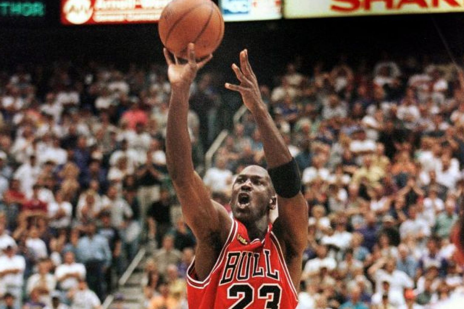 With 5.2 seconds left, Michael Jordan aims and takes the Game Six-winning jump shot in the 1998 NBA Finals against the Utah Jazz in Salt Lake City. The Chicago Bulls won 87-86 to clinch the series for their sixth title and second hat-trick.