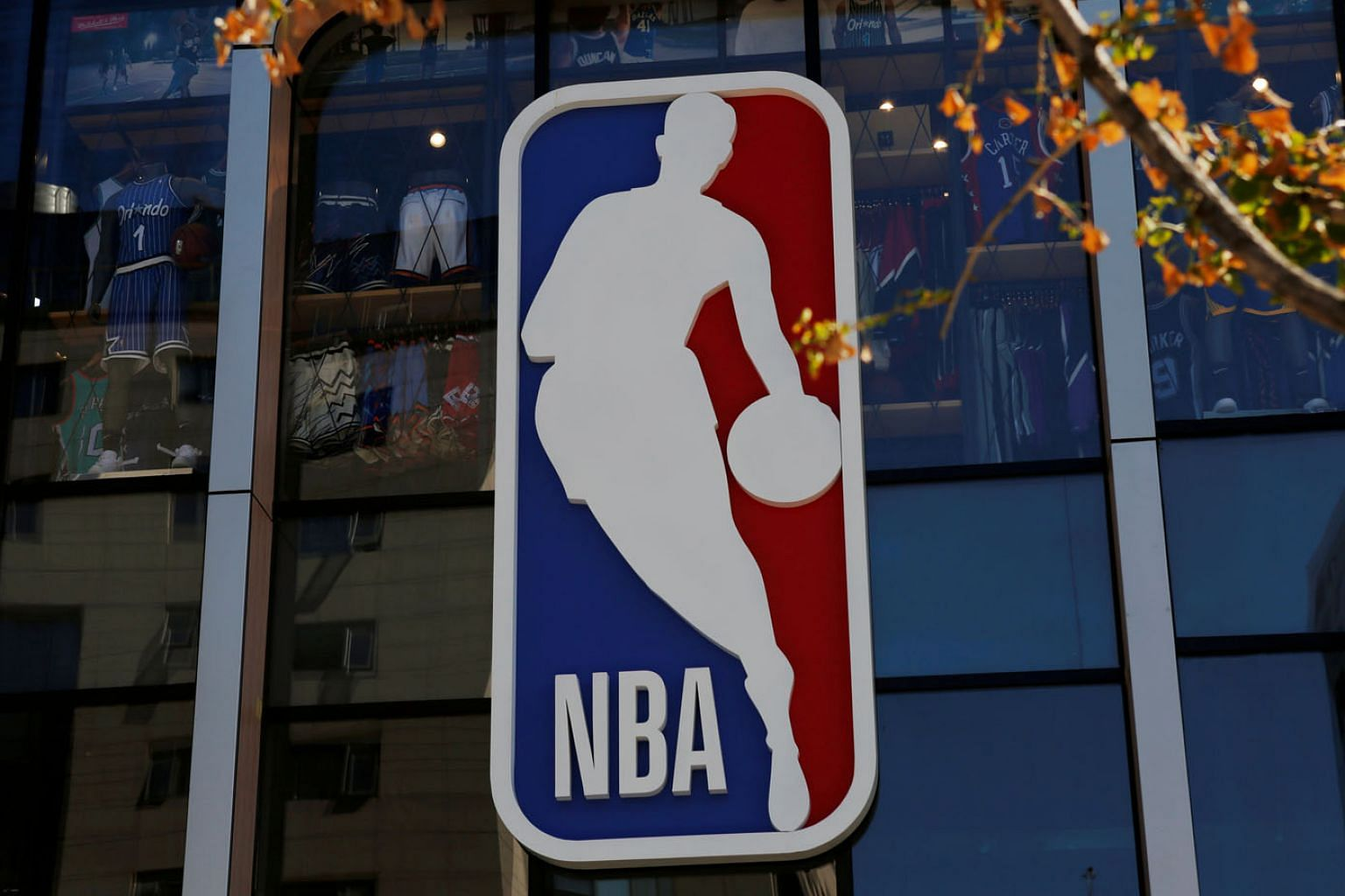 The NBA logo is seen at its flagship store in Beijing last year. The backlash has cast a cloud over its merchandising interests in China.