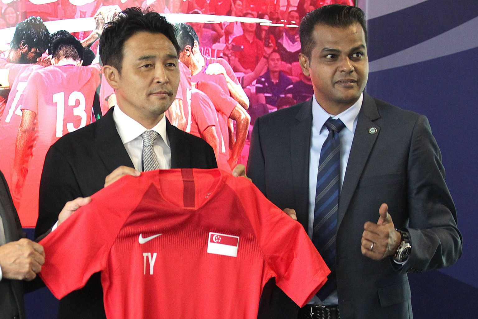 National coach Tatsuma Yoshida (left) was inspired by front line workers to give to a good cause while FAS general secretary Yazeen Buhari was moved to help underprivileged youths.
