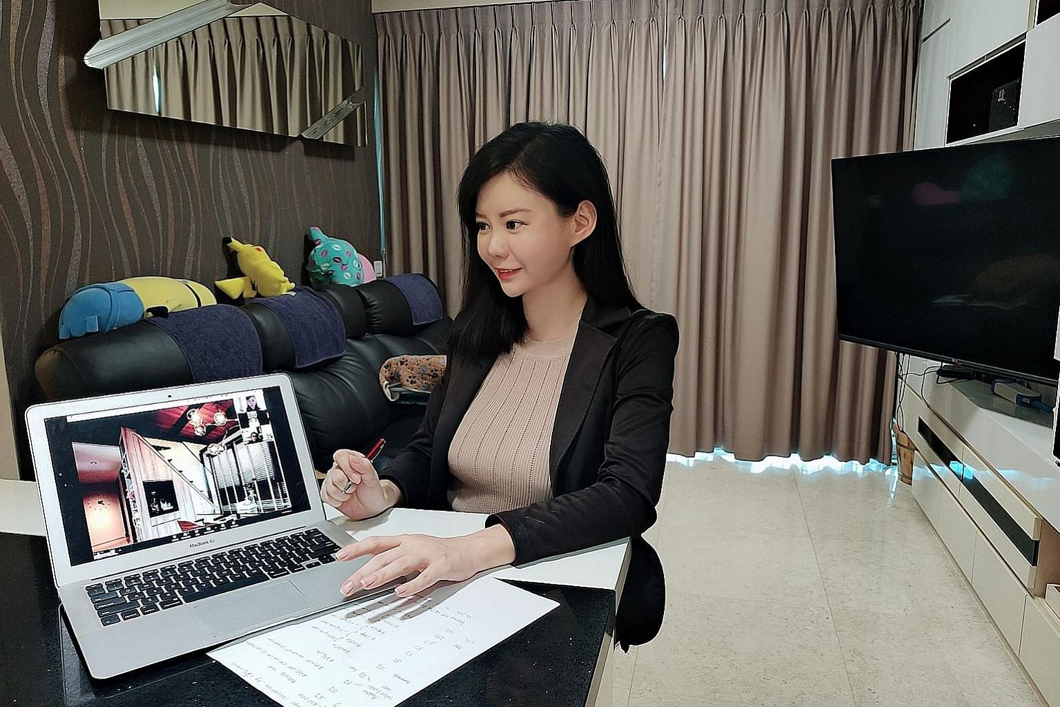 Huttons Asia property agent Charlyene Choo, 35, conducting a virtual viewing of a three-bedroom condo unit in Sengkang for a potential buyer. She has conducted at least five real-time viewings through Zoom during the circuit breaker period.