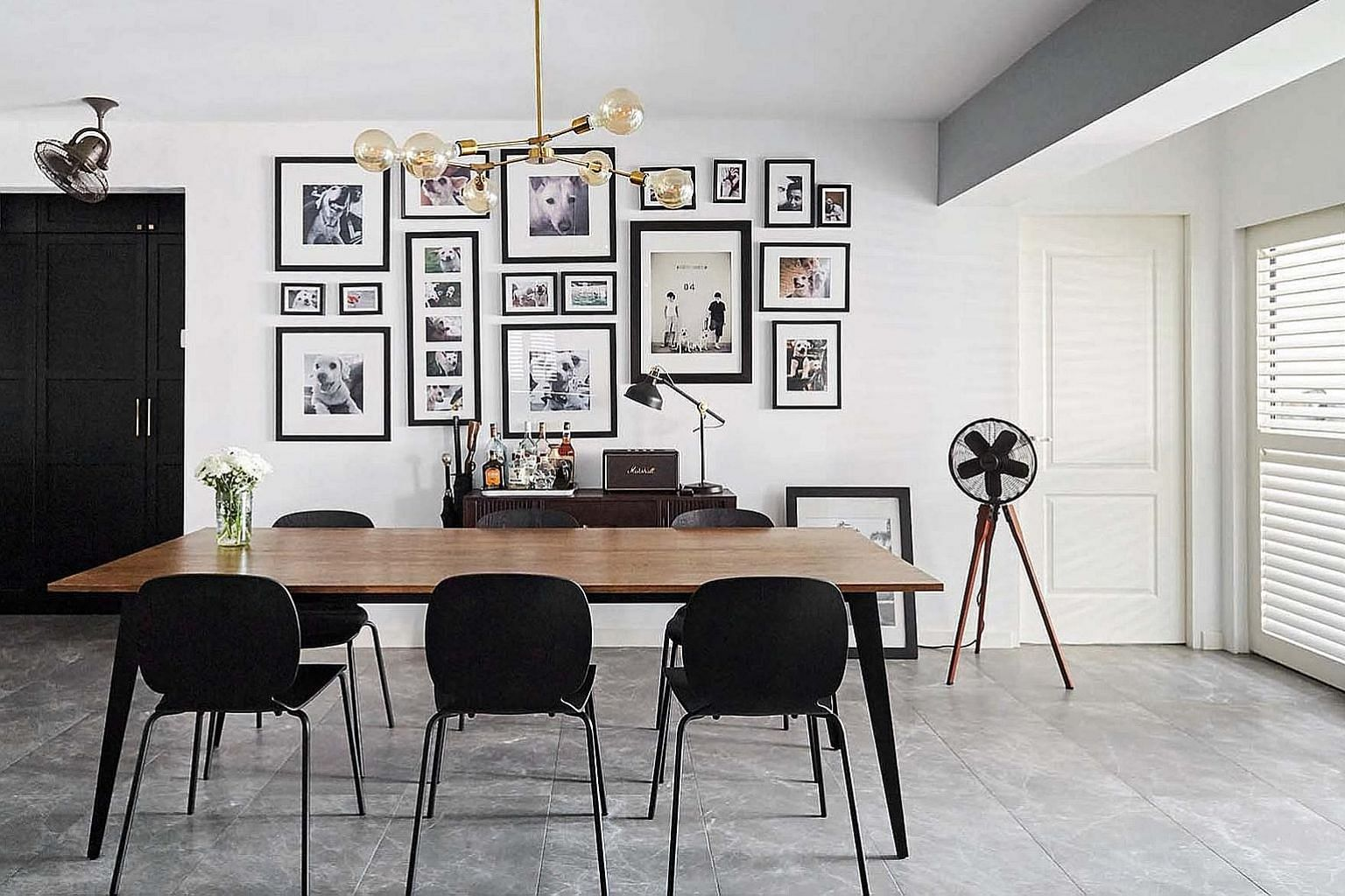 A wall of photographs near the dining table is an ode to the dogs of the home owners.