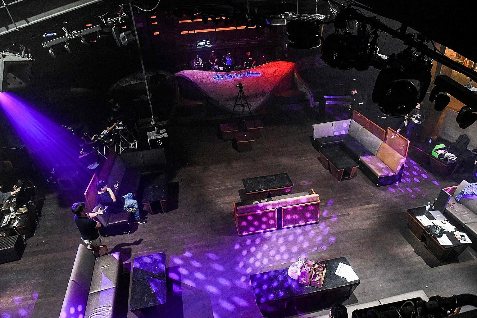 """Nightclub Zouk's DJs performing in front of a video camera in the empty club on March 27 during a """"cloud-clubbing"""" party that was livestreamed following the closure of entertainment venues in Singapore."""