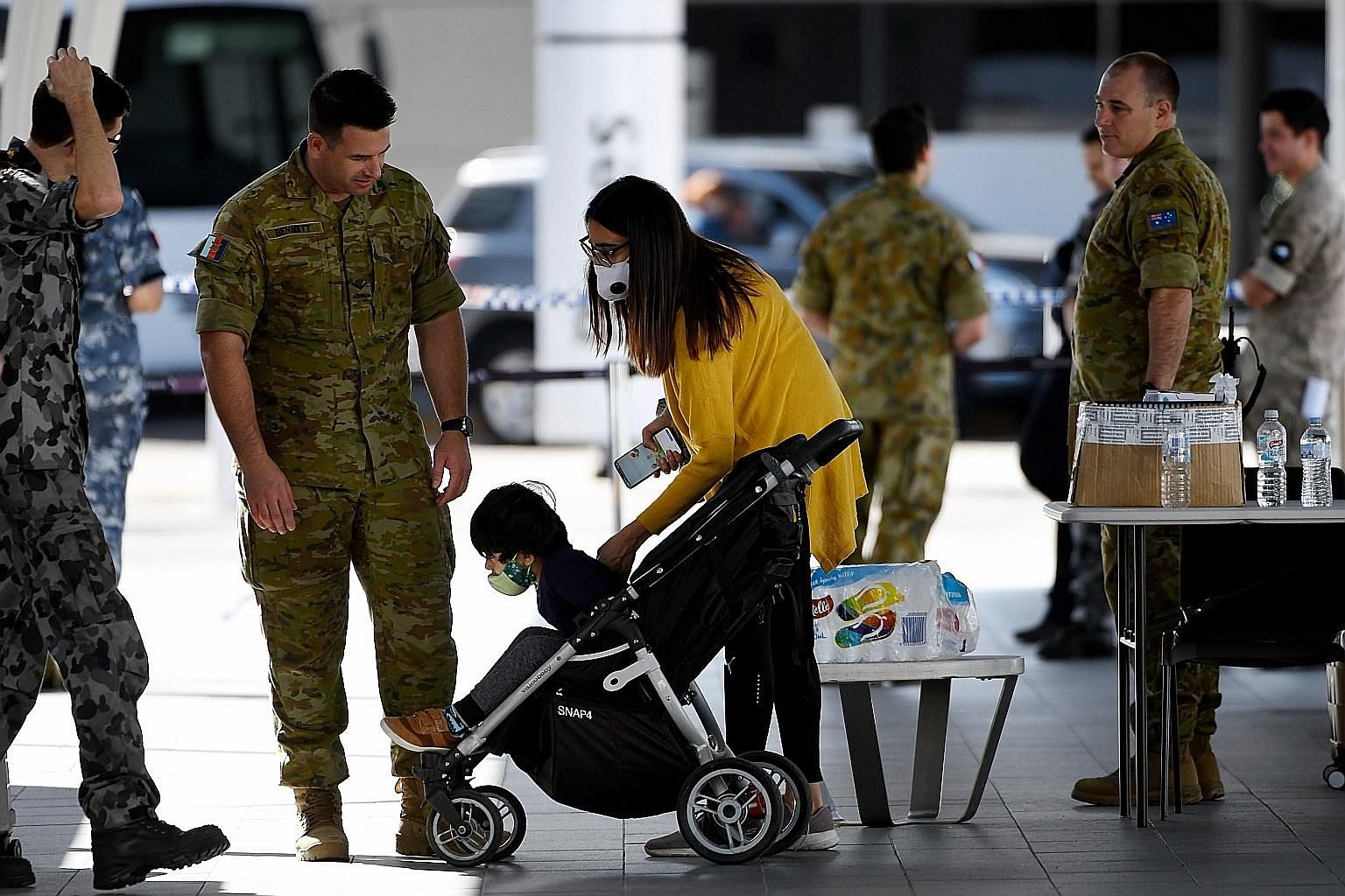 Australian residents being helped by military staff after arriving at the Sydney airport during the pandemic. The Morrison government has called for an international inquiry into the origins of the coronavirus.