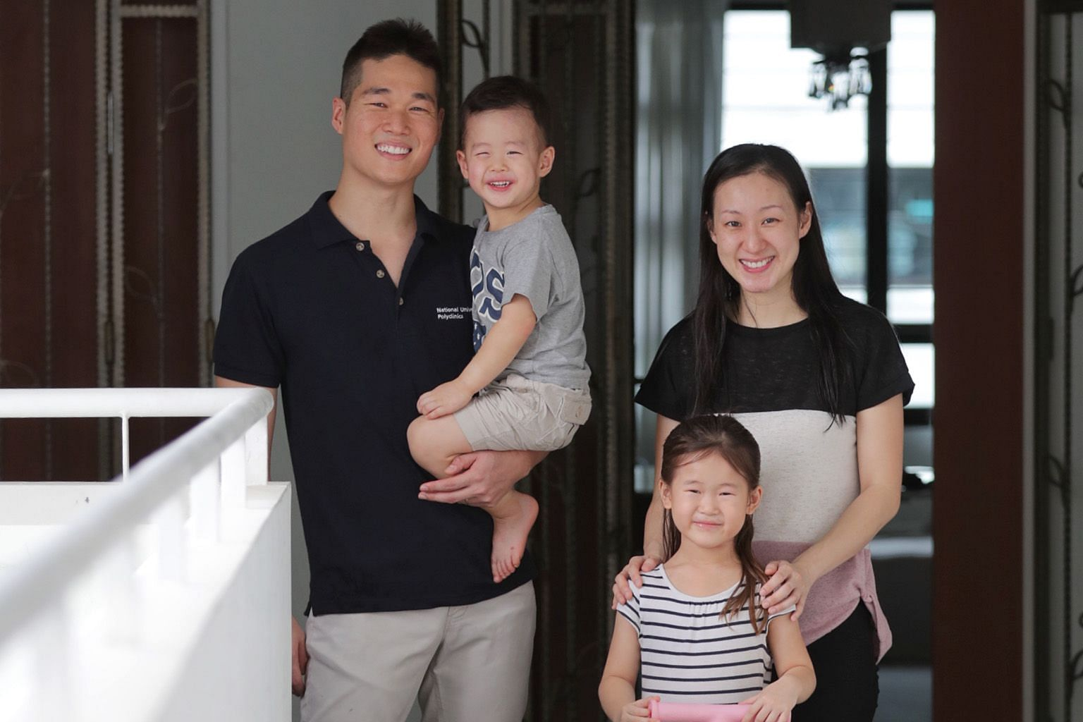 Dr Hou Minsheng, 32, a family physician at Choa Chu Kang Polyclinic, with his wife Deborah, also 32, a dentist by training, and their children - five-year-old Hannah and three-year-old Ethan.