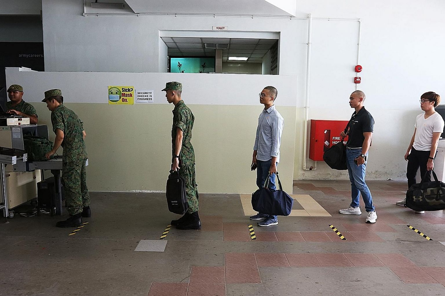 Recruits on their day of enlistment at the SAF Ferry Terminal on April 1. The resumption of basic military training is necessary to generate operational units as well as select commanders for training at the Officer Cadet and Specialist Cadet schools