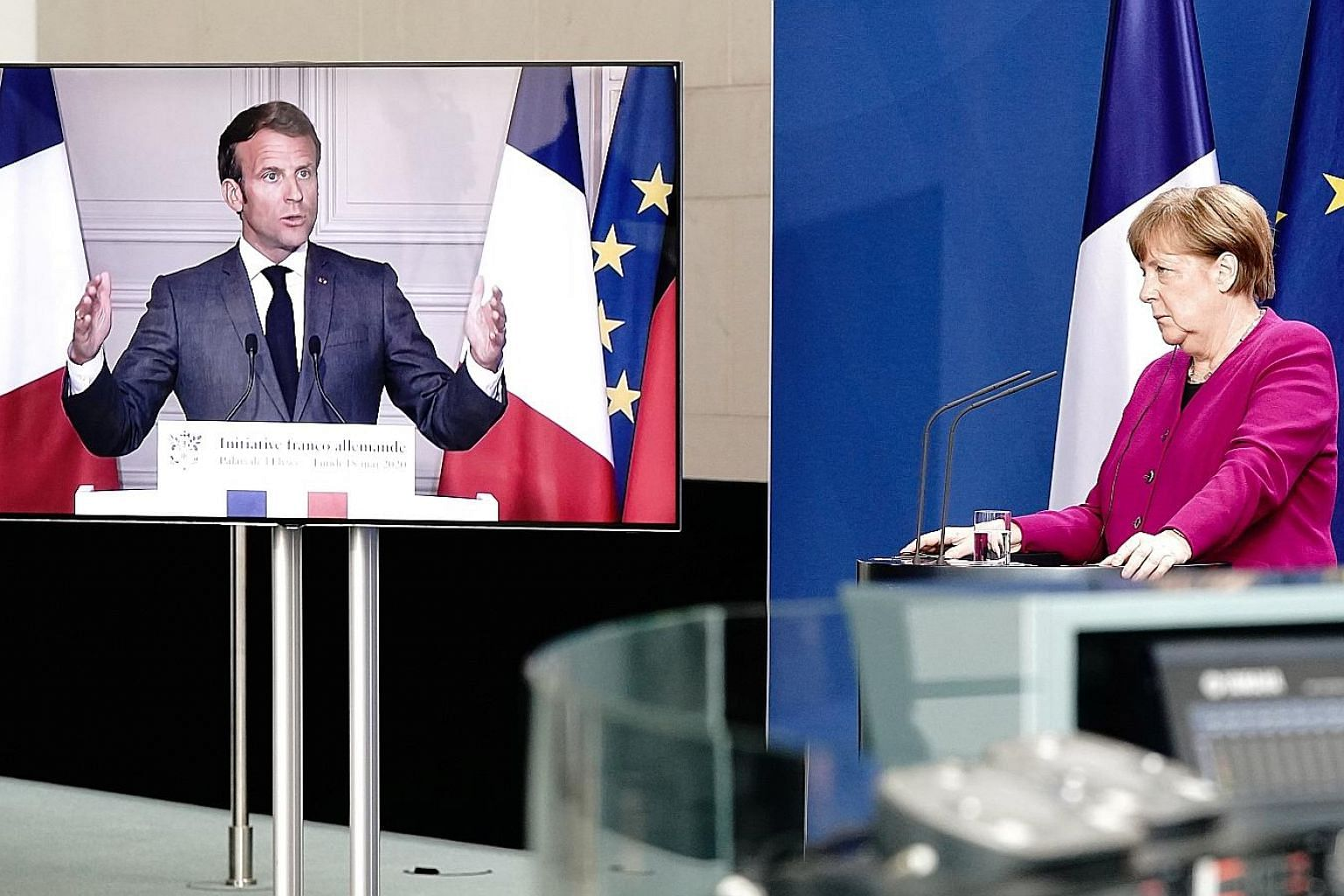 French President Emmanuel Macron and German Chancellor Angela Merkel at their joint video news conference on Monday, during which they supported the idea of creating a €500 billion (S$775 billion) bond designed to assist countries and industries se