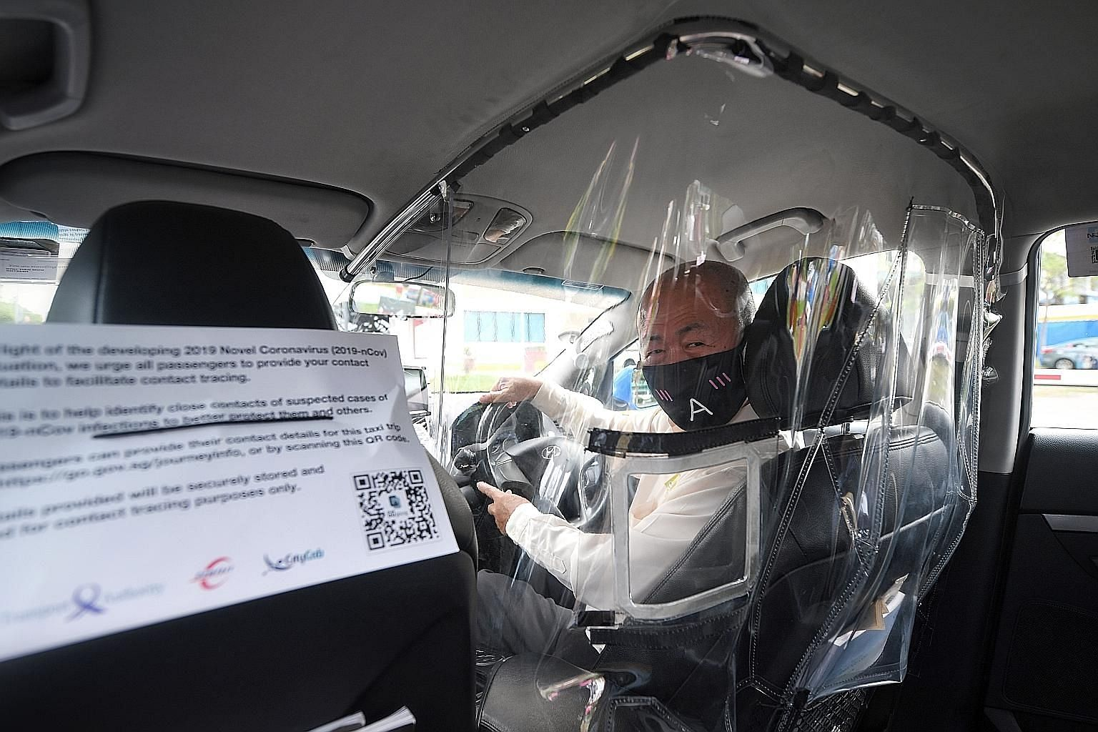 Taxi driver Koh Tian Moo, 66, in a cab that has been fitted with a plastic shield to minimise contact between drivers and passengers amid the Covid-19 outbreak. ComfortDelGro Corp will fit 400 of its 10,000 cabs with these shields as part of a trial.