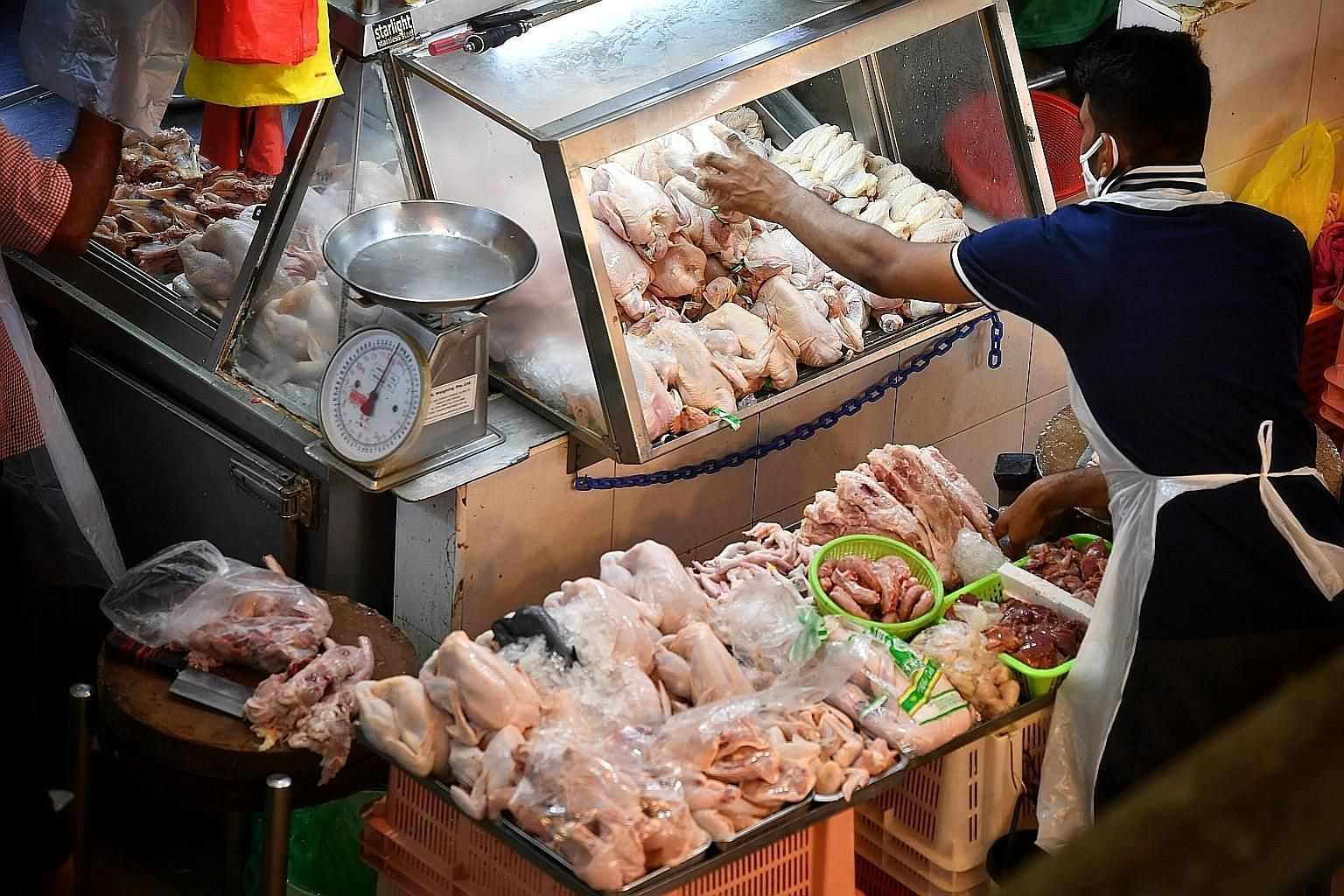 A poultry stall at Tekka Market. Some chicken sellers said although they had seen prices of chicken from Malaysia go up by about 20 to 30 cents per kg last month, they have been absorbing the increased costs.
