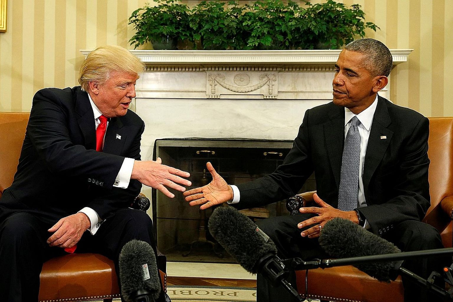 President-elect Donald Trump meeting then President Barack Obama in the White House Oval Office on Nov 10, 2016. Mr Trump's caricatures of the Obama era are red meat to those who believe only Mr Trump can Keep America Great, say the writers.