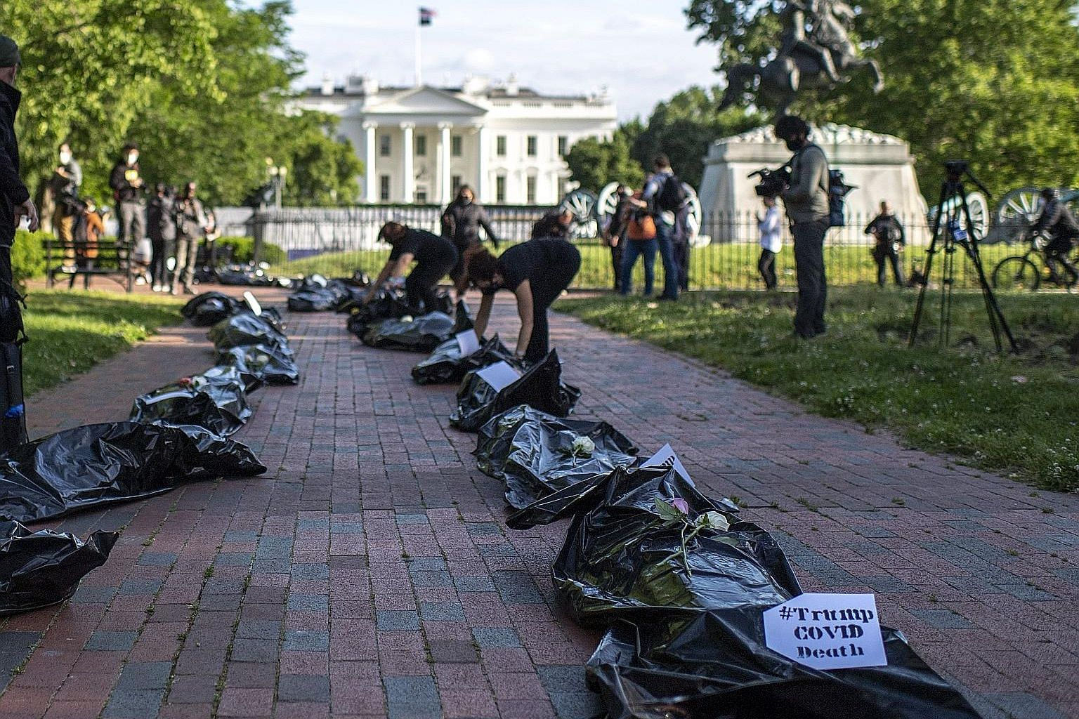 Demonstrators displaying fake body bags during a protest in front of the White House in Washington on Wednesday. The Bill passed by the US Senate applies to all foreign companies, but targets China's unwillingness to allow American regulators to rout