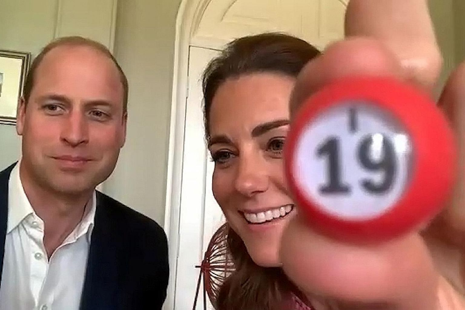 Prince William and Kate Middleton took turns to call out the numbers generated by their own bingo spinner as they joined in the game with the residents of Shire Hall Care Home.
