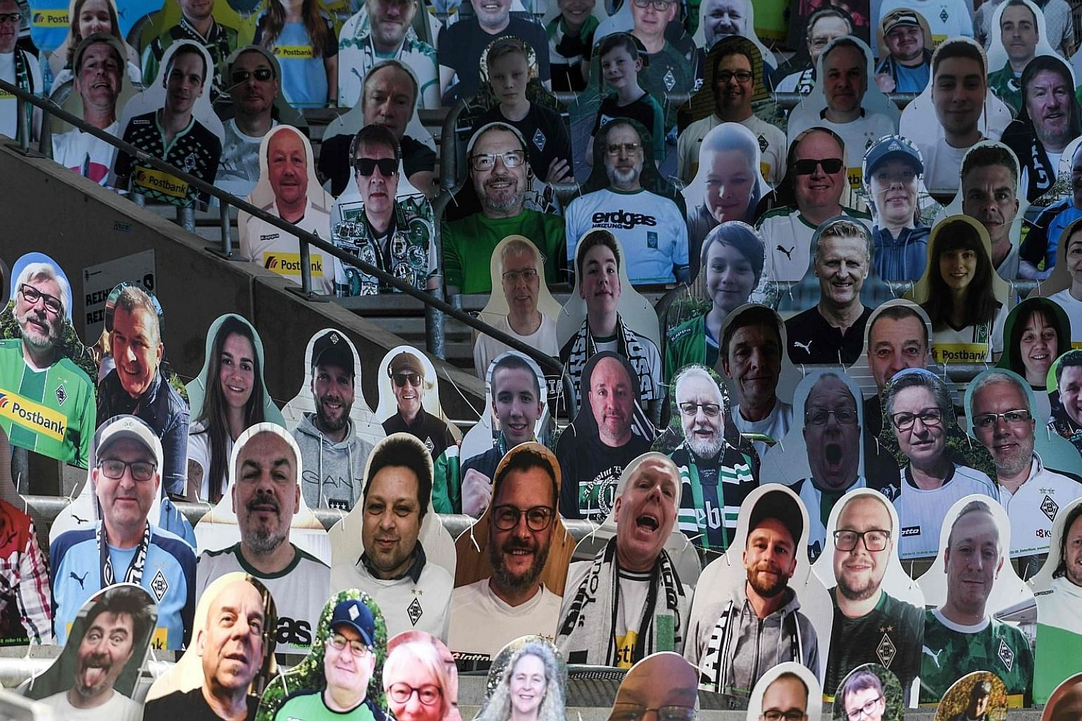 Cardboard cut-outs with portraits of Monchengladbach supporters at the Bundesliga side's ground on Tuesday. These and other gimmicks such as piped-in crowd noise are a poor substitute for live roaring fans.
