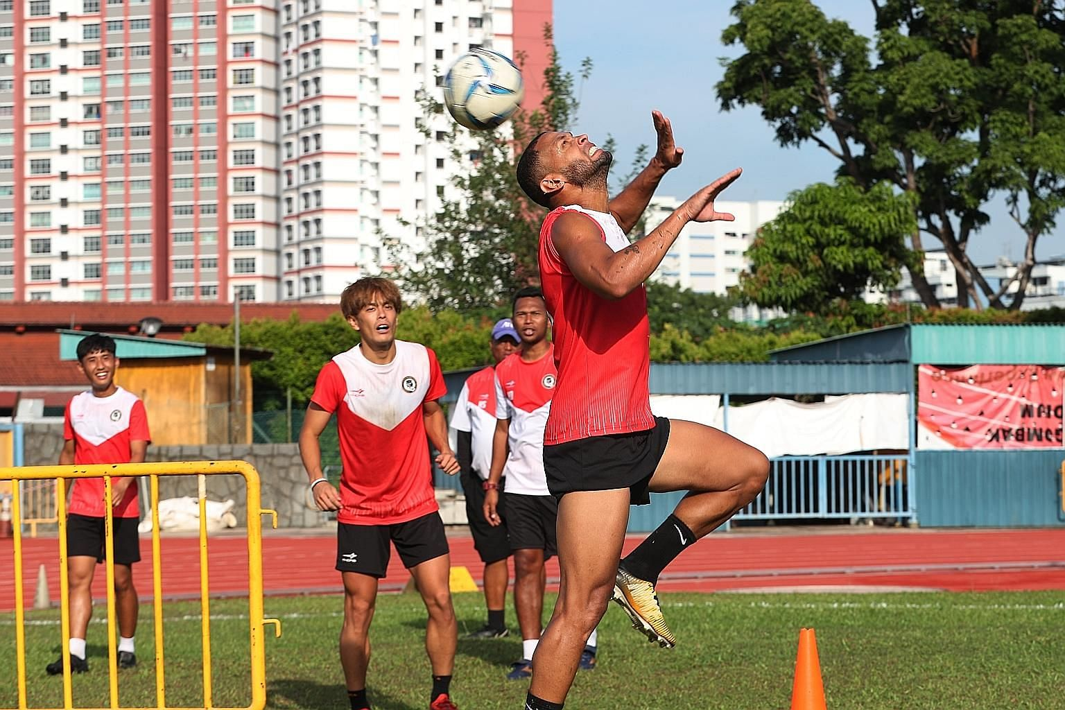 Tanjong Pagar's Luiz Junior heading the ball during pre-season training in February. The FAS last month disbursed an additional subsidy of over $600,000 for local clubs to pay their players' full wages during the SPL hiatus.
