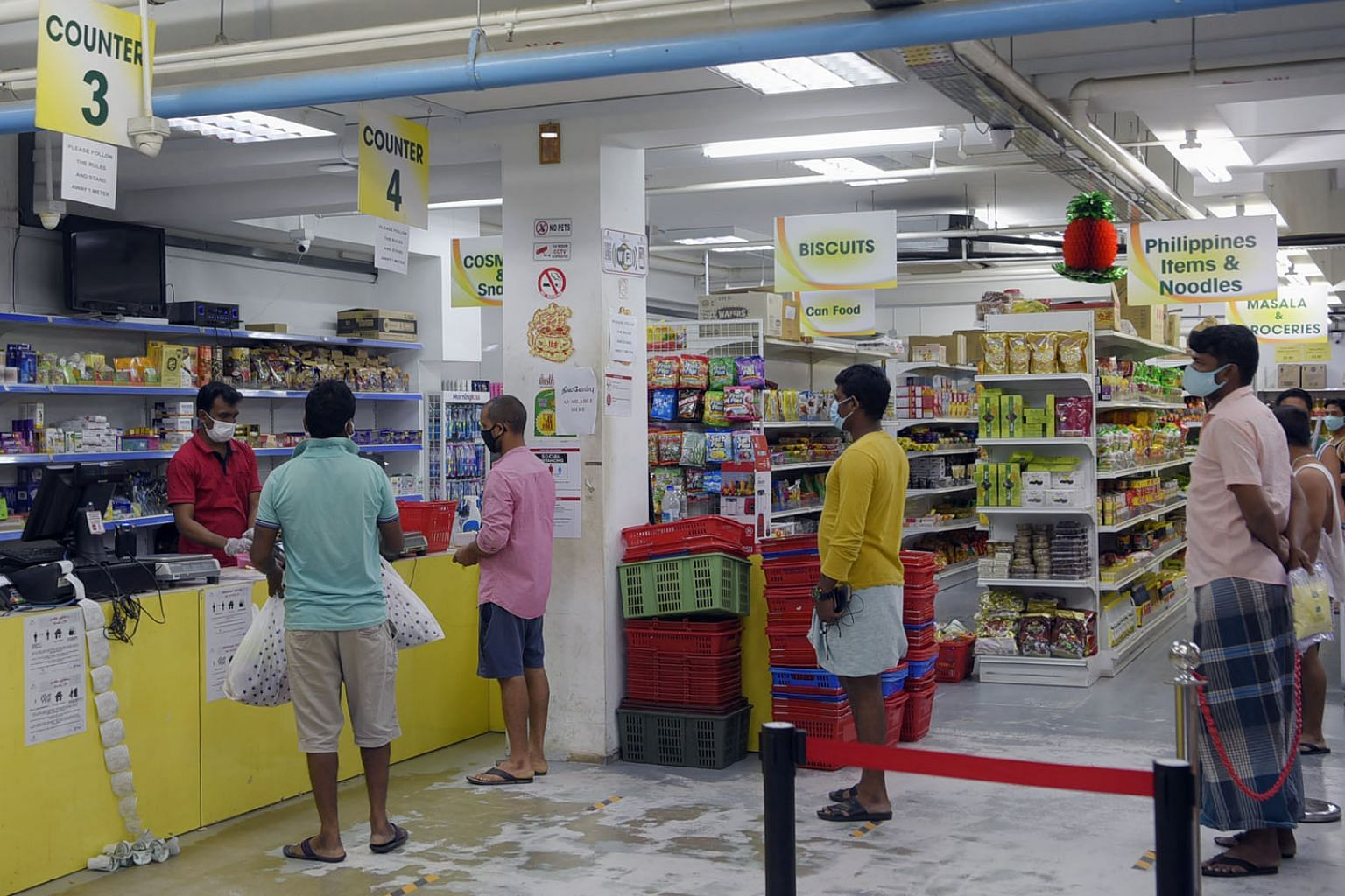 Foreign workers shopping at a supermarket within their dormitory complex. The writer says his idea of floating islands for migrant worker housing is a win-win proposition - offering opportunities to reduce the risk of another pandemic and realise the