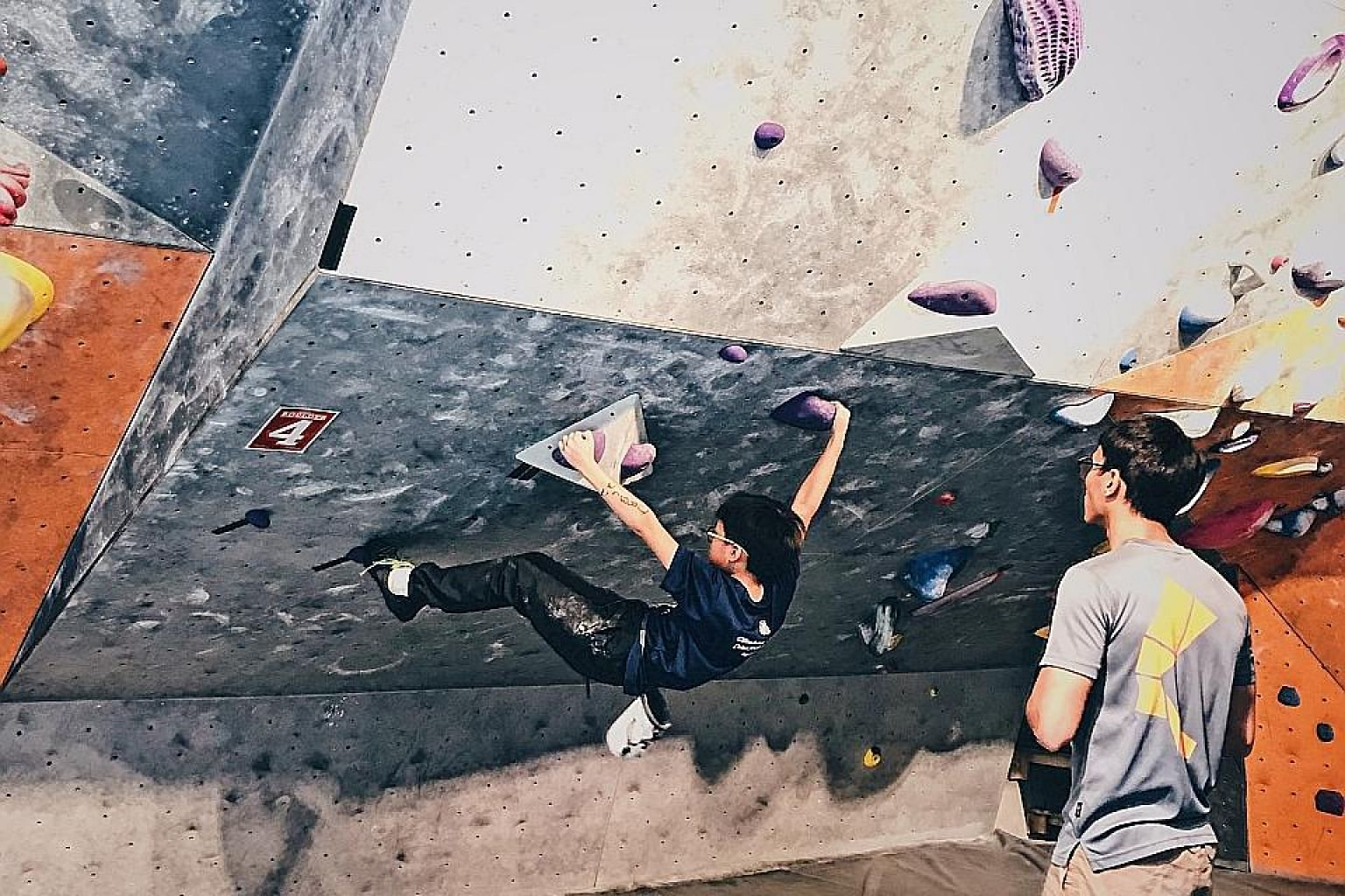 Primary 6 pupil Dylan Seow, 11, participating in a rock-climbing competition last year. He is applying for this year's Direct School Admission exercise through the sport.