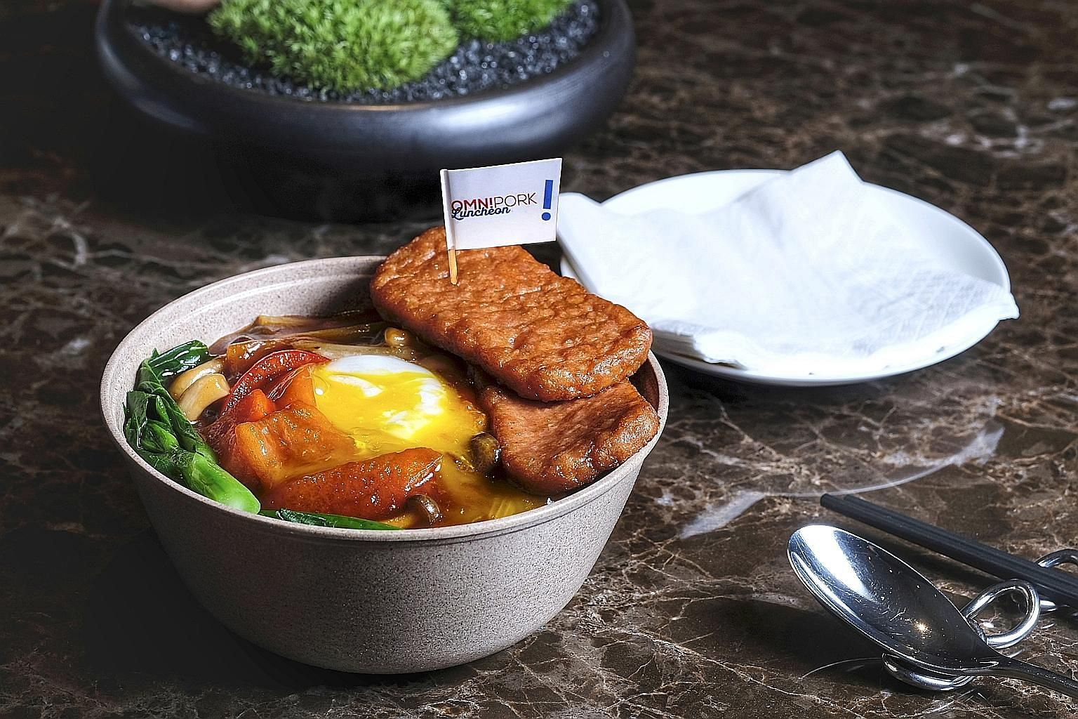 This dish of luncheon meat with egg and rice in spicy tomato sauce is made with OmniMeat luncheon meat. Retail packs of the plant-based meat will be launched in Singapore in September.