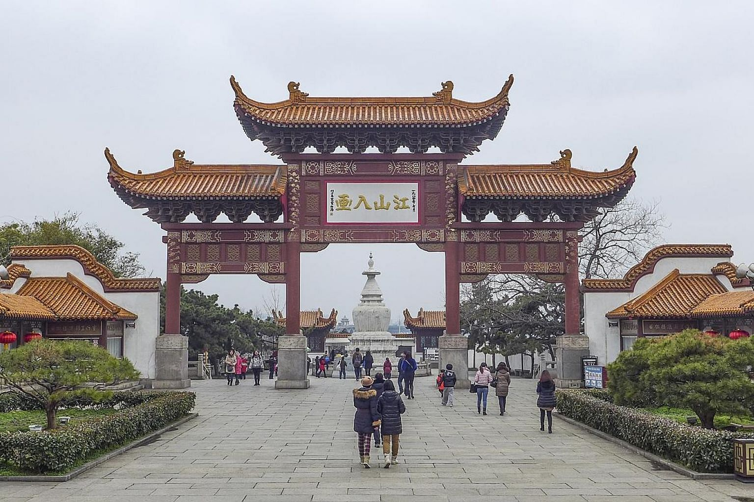 The grand entrance (above) to the Yellow Crane Tower. The complex also has other architecture, such as a red pagoda that houses a giant bell.