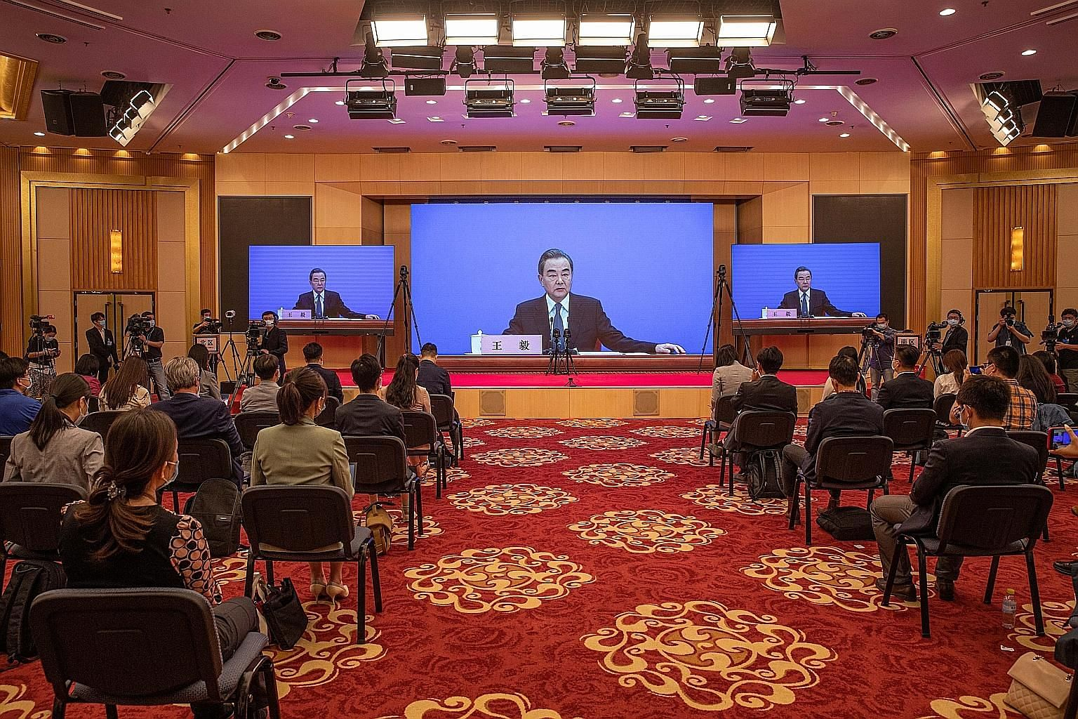 Chinese Foreign Minister Wang Yi speaking to reporters at a virtual briefing on the sidelines of China's legislative meetings in Beijing yesterday. Mr Wang said China has been working with Asean countries to beat the coronavirus, adding that ships an