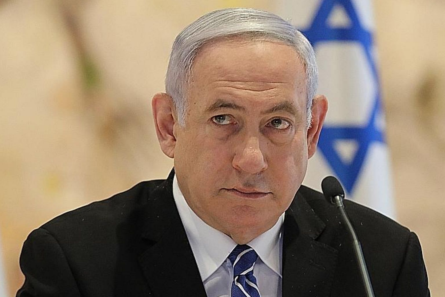Under Israeli law, Benjamin Netanyahu, a sitting prime minister, need not resign when facing charges.