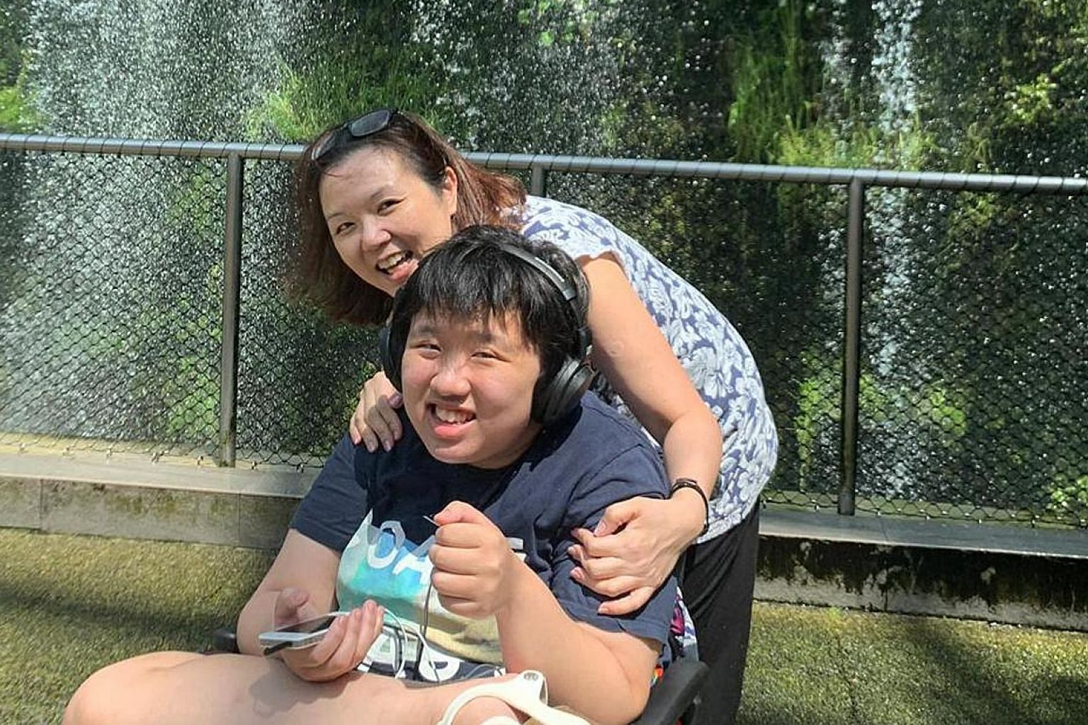 Amanda Khoo with her mum, who wants to be known only as Madam K. Ooi, at Changi Airport, one of her favourite places to visit, before the circuit breaker period started. The teenager has severe autism and wants to go outdoors, but refuses to wear a m