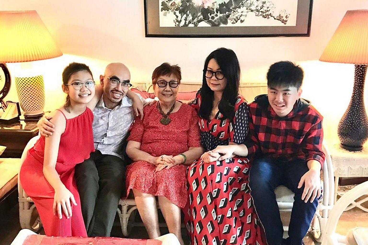 Mrs Florence Choy (next to her son Julian) says he has moderate autism and misses going to school, working out at the gym and having play dates with his friends - and sometimes has a meltdown. Ms Magdalene Ong has kept her son Chalmers Wong occupied