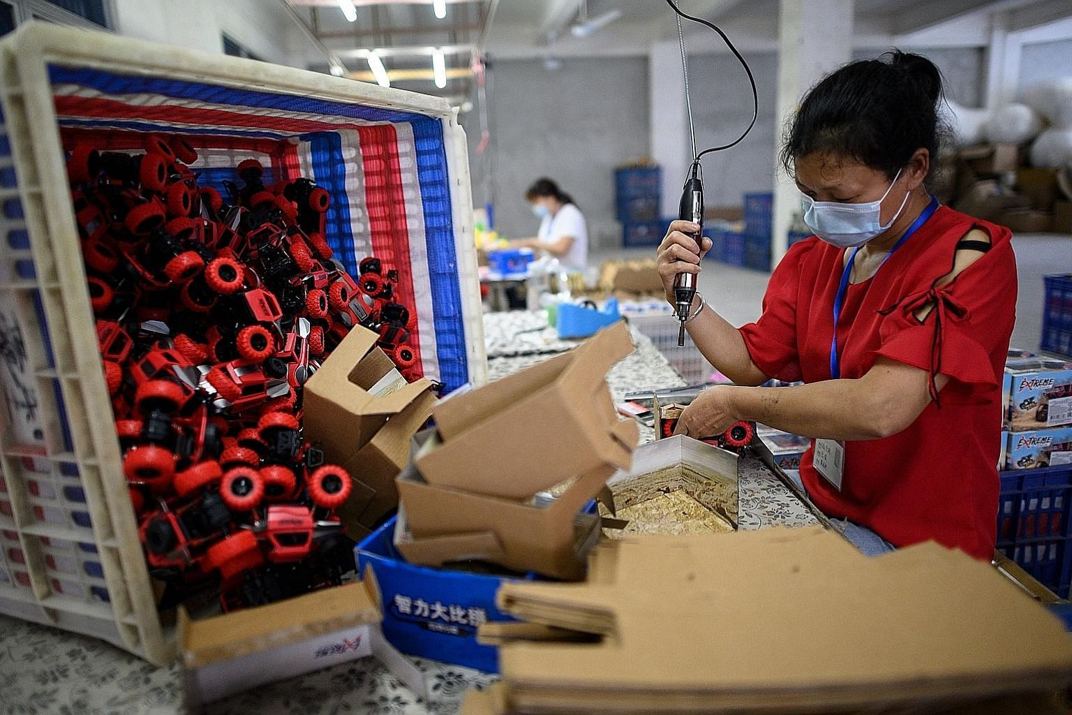 A worker assembling toy cars at a Shantou factory in China's Guangdong province last week. China's economy is stirring back to life after virus cases dwindled from a peak in February, when activity came to a near-halt. But recovery is now hampered by