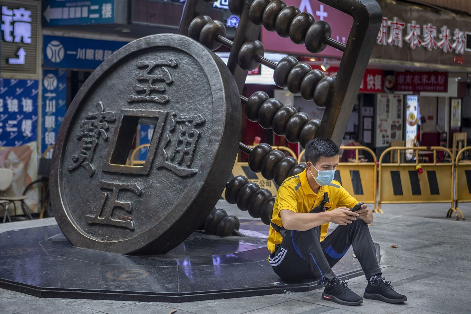 A sculpture depicting the Chinese yuan and abacus in Guangzhou in China's Guangdong province. An official Chinese digital yuan is now in pilot runs to slowly start replacing the physical legal tender. If the experiment succeeds, it will become the wo